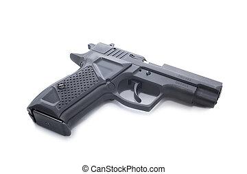 Gun - black hand gun isolated on a white background