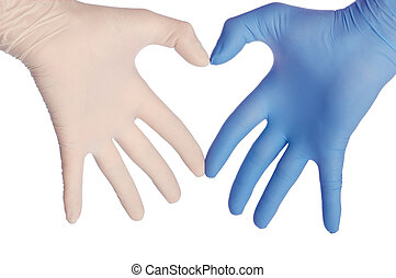saving lifes - cardiologist in blue and white gloves saving...