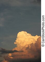 Cumulonimbus Clouds - Evening twighlight casting colors on...