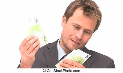 Businessman counting money against a white background