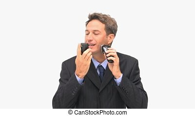Time pressured businessman against a white background