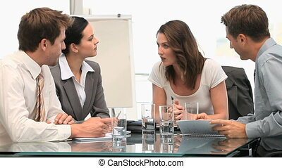 Female manager speaking with her team - Woman manager...