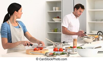 Beautiful couple cooking at diner - Beautiful couple cooking...