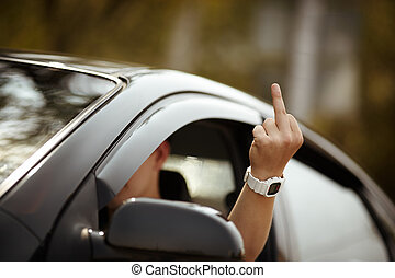 aggression on the road - young driver shows middle finger,...