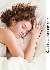 Sleeping young woman - Pretty young woman sleeps in her bed