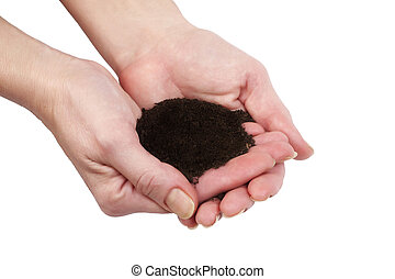 Female hands holding humus soil - close up