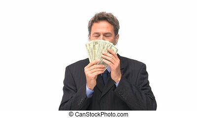 Businessman kissing his money against a white background