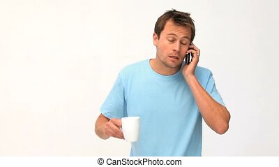 Man phoning while he is drinking against a white background