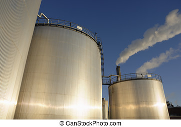 oil and fuel tanks - oil and fuel storage tanks gleaming at...