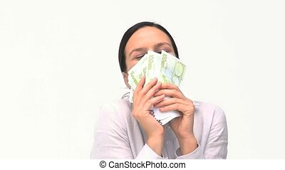 Businesswoman hugging her money against a white background