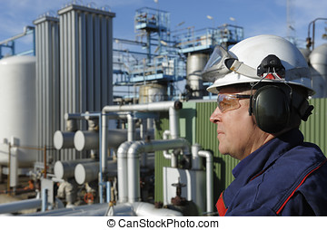 oil and fuel worker - oil-worker in profile with industry in...
