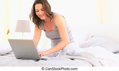 Woman looking at her laptop - Splendid woman looking her...