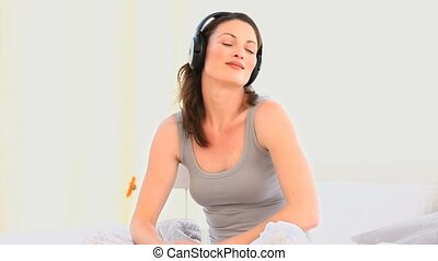 A lovely woman listening to music