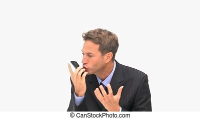 Angry businessman phoning against a white background