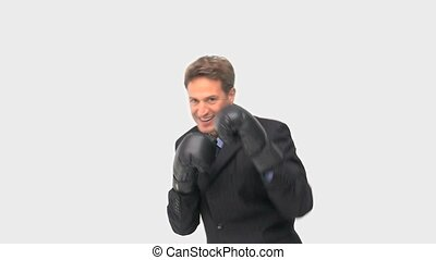 Happy businessman boxing towards the camera against a white...