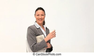Beautiful businesswoman with a drink