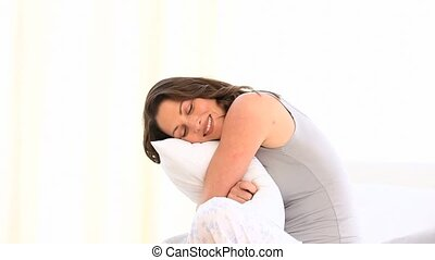 A lovely girl hugging her pillow