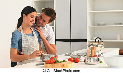 Lovely couple cooking together in the kitchen