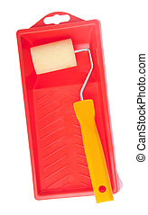 Paint roller and tray - small paint roll utensil on a red...