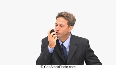 An angry business man phoning