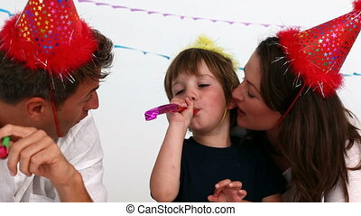 Parents playing with their son on his birthday