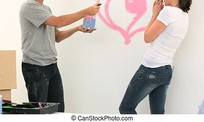 Nice couple paiting a wall together