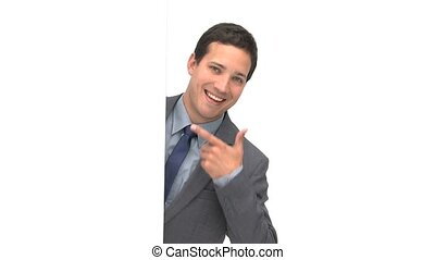 Happy businessman pointing a white board and smiling to the camera