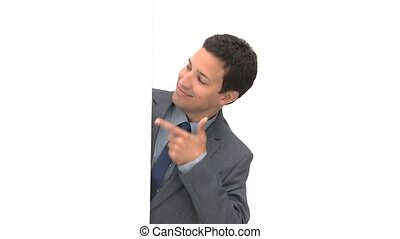 Happy businessman pointing a white board against a white...