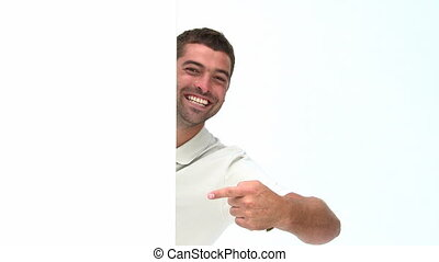 Happy man showing a white board isolated on a white...