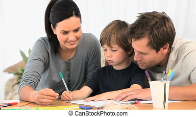 Parents drawing with their son