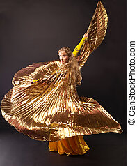 Beauty woman dance with gold wing - Beauty mature woman...