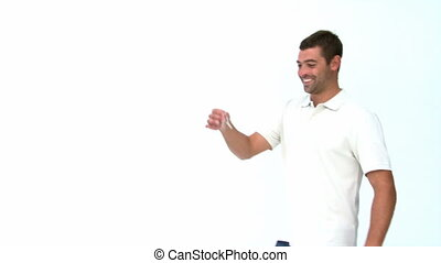Man showing a for sale board against a white background