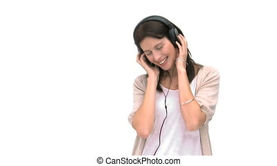 Woman smiling at the camera while she's listening to music...