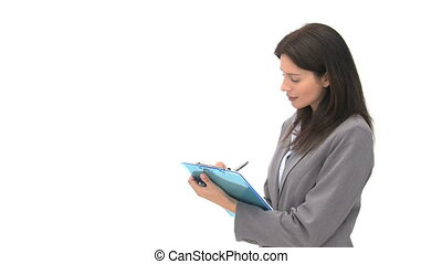 Smiling businessman writting on her notebook against a white...