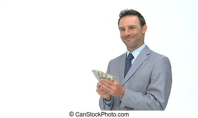 Happy businessman holding dollars against a white background