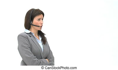 Annoyed businesswoman talking with headphones isolated on a...