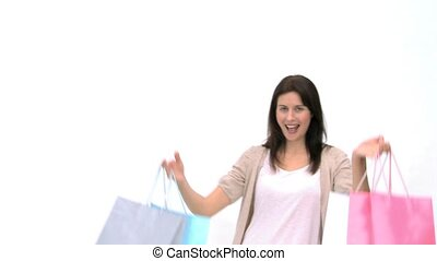 Happy woman with shopping bags against a whit background