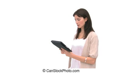 Woman using a computer tablet against a white background