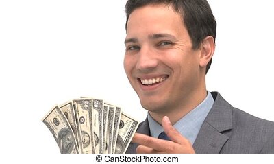 Smiling man pointing dollars against a white background