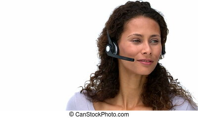 Joyful businesswoman talking with headphones against a white...