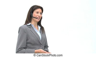 Smiling businesswoman talking with headphones isolated on a...