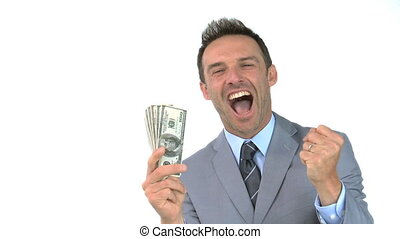 Smiling man holding dollars against a white background