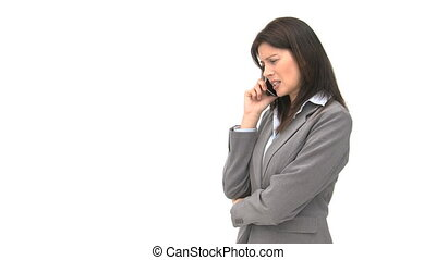 Angry businesswoman talking on the phone against a white...