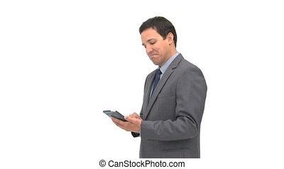 Smiling businessman using a computer tablet against a white...