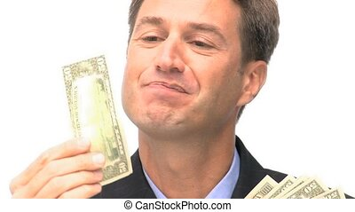 Happy businessman looking and at and kissing his money -...