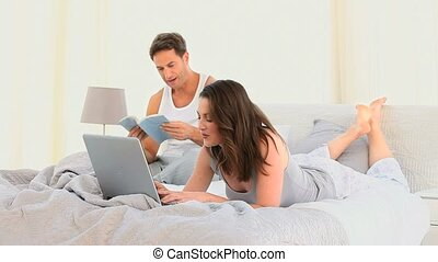 Beautiful couple on their bed at home