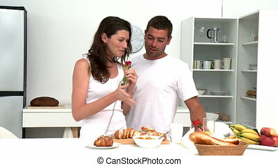 Couple having breakfast in the kitchen