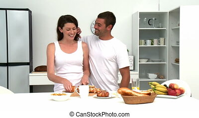 Man hugging his wife befor they having breakfast in the...
