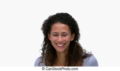 Happy woman in front of the camera against a white...