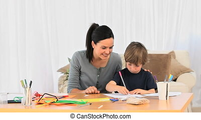 Cute mother drawing with her son